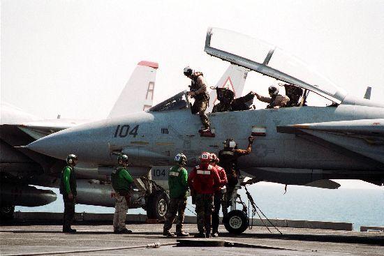 F14 pilots exiting their plane.