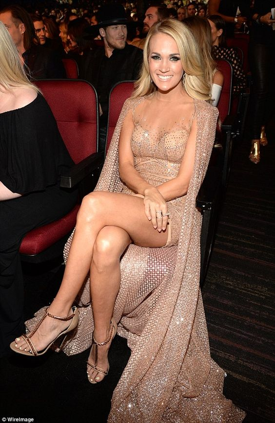 Bronze beauty: The stunning blonde glowed in her nude, caped dress