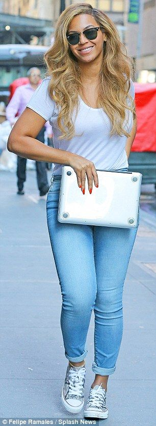 Comfy: The singer wore a tight white T-shirt with cropped black jeans and sneakers