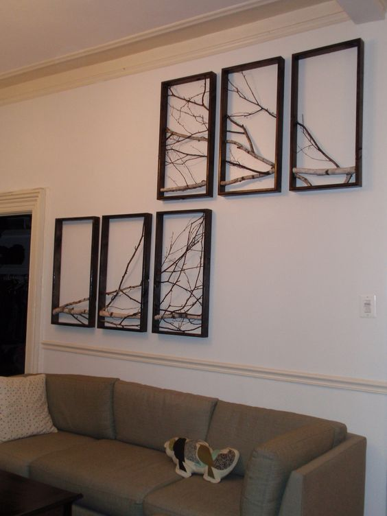 Branch art using multiple frames... I've been considering doing a single large frame for the living room, but I like this idea, too!: