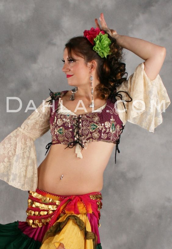 Dahlal Internationale Store - Tribal Lace Up Top of Vintage Sari Fabric, $39.95 (https://www.dahlal.com/tribal-lace-up-top-of-vintage-sari-fabric/)