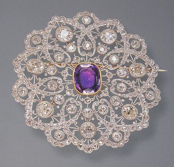 Exquisite platinum, 18k gold Edwardian brooch set with diamonds & an emerald cut amethyst.:
