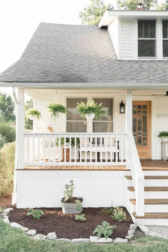 I've partnered up with Lowe's Home Improvement to completely transform the outdated exterior of our nearly 100 year old home.I don't know if I have ever been more excited to publish a post than this one right here! I can't believe the difference this project has made for the curb appeal on our 1920's bungalow farmhouse. #homeimprovementprojects
