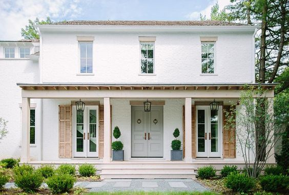 Brick exterior home with grey door shutters white brick for Cobblestone shutters