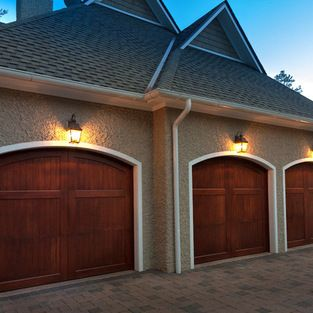 Carriage House Garage Doors - These wood stained garage doors by Carriage House can be customized and installed by Automatic Door Specialist...