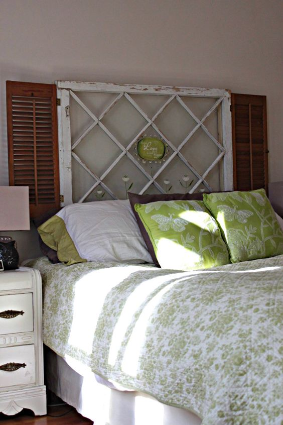 Love this headboard made out of old an old window and shutters.