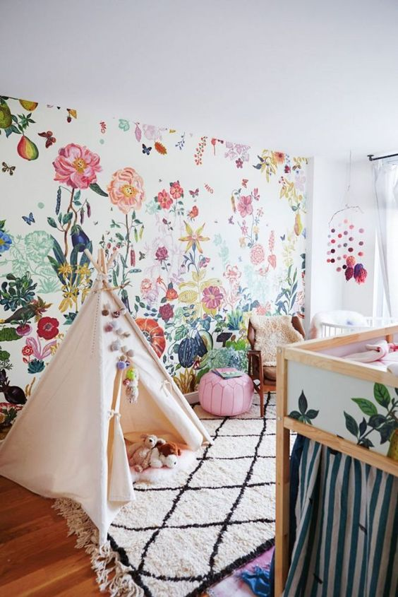 sweet floral wallpaper and Moroccan rug mix in this kids room!: