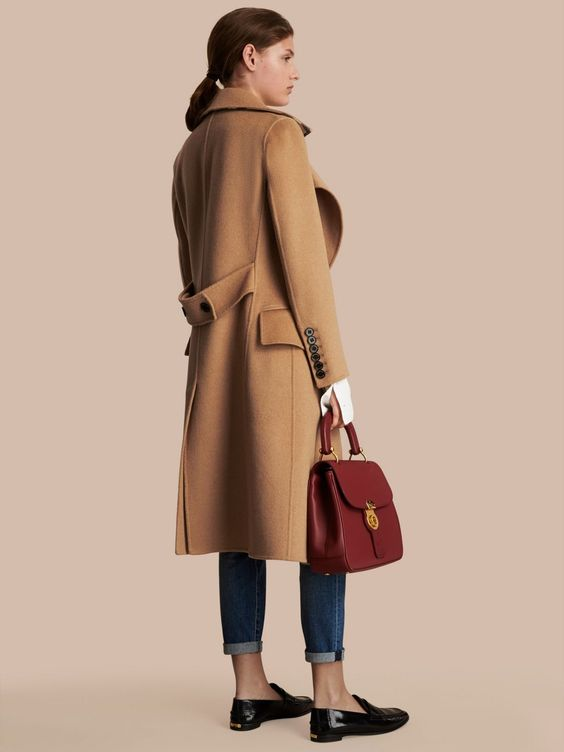 A double-faced camel hair and wool coat cut slim with a softly draped front for femininity. The elegant silhouette is relaxed over casual and smart layers alike.