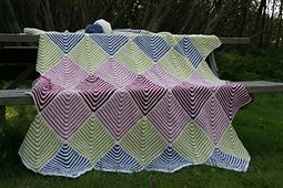 Ravelry: Mitered Blanket #4752 pattern by Bernat Design Studio
