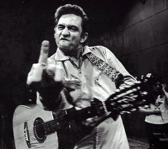 The infamous photo of Cash giving the middle finger to the camera was taken back in 1969 during his San Quentin prison performance.