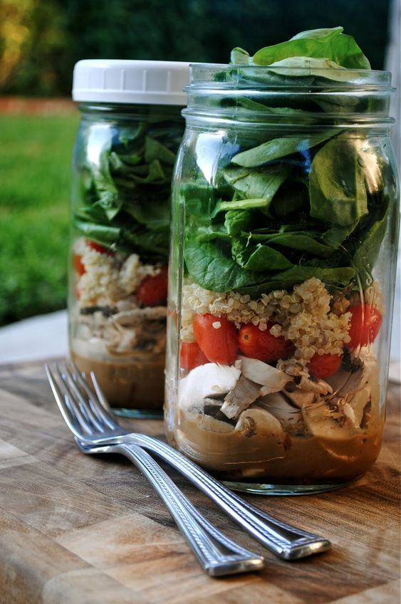 "Jar salads. ""The most important part of the layering is making sure the dressing and the spinach (or whatever 'leaf' you choose) don't touch. As long as they stay separate, these salads can be made up to 4 days in advance and will stay fresh in the fridge with a lid on. This is one of my tricks to eating salad everyday for lunch at work. I make a few jars on Sunday night and just grab one to bring to work everyday. When you're ready to eat, just shake it up."""
