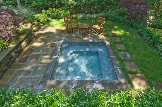 This rectangle pool is small enough to fit in any backyard but large enough to really enjoy. It has benches and built in stairs to make it easier to use and it's surrounded by greenery.