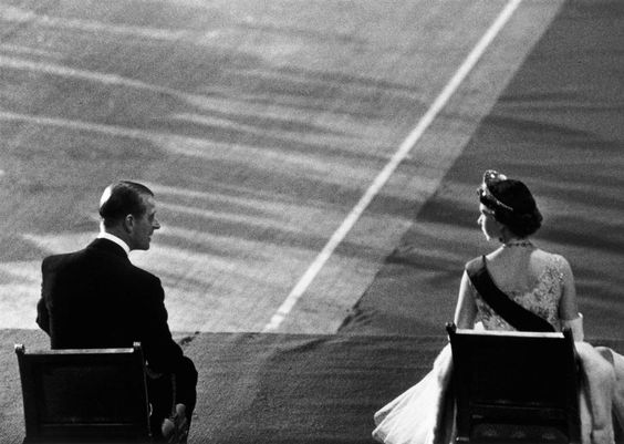 USA. 1957. Queen Elizabeth and Prince Phillip during the Queen's visit to the United States by Cornell Capa. Magnum Photos