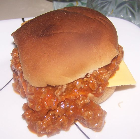 These are the homemade Sloppy Joes my family loves. 1 lb. ground round, 1 lg. green bell pepper- chopped fine, 1 lg. onion- chopped fine, 1 1/2 cans reduced-sodium tomato soup; whole-wheat buns. Cook the first 3 ingredients until meat is browned & vegetables are tender. Drain well & return to frying pan. Add the tomato soup to beef & stir well. Simmer for 10 min. Calories: 318; Protein: 23 g; Carb: 29 g; Total fat: 13 g; Sat fat: 5 g; Fiber 3 g; Sodium: 399 mg