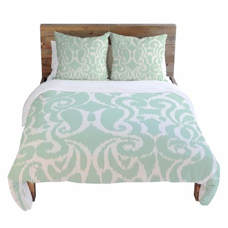 Such a pretty mint green duvet cover! Cool fresh pattern, too.