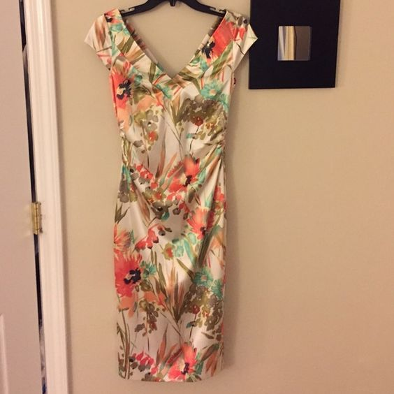 """Floral midi dress Floral (watercolor print?) knee length dress (I'm 5""""9)  by Maggy London. I purchased this dress from a consignment shop. I've worn twice since and it has been dry cleaned. Maggy London Dresses Midi"""