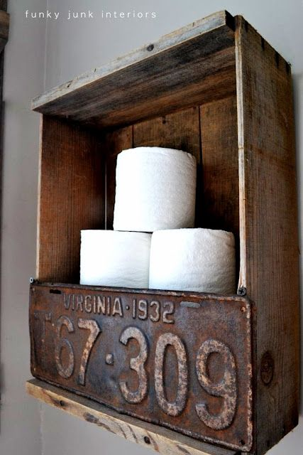 Rustic crate and license plate toilet paper holder.