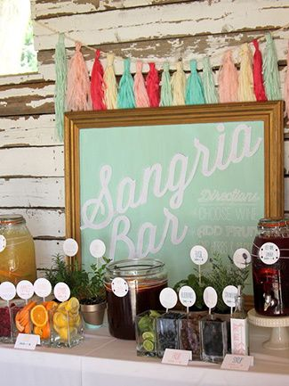 Sangria bar - esp. love the idea of the frame with a poster to announce party theme/menu/etc.