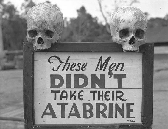 """Gefunden auf: http://heftig.co/fotos-aus-der-vergangenheit/ """"Werbung für Atabrine, ein Mittel gegen Malaria, in Papua Neu Guinea während des 2. Weltkriegs."""""""