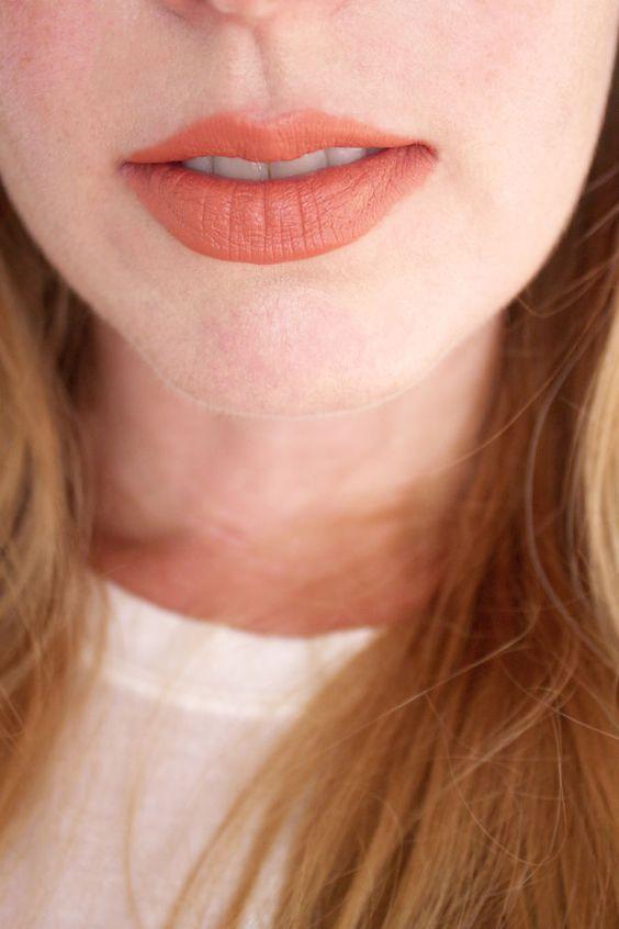 Bite Beauty Multistick in Praline, on lips.