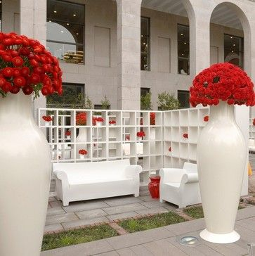 Misses Flower Power Vase and Bubble Club sofa by Kartell