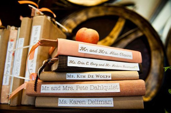 Now this would be amazing. 100+ books lined up as place cards.