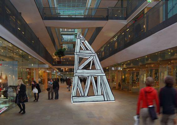 El objeto creado por Luis úrculo consiste en una estructura metálica forrada de metacrilato blanco e iluminada con hilo luminoso fino por el interior. En el exterior, vinilo negro imita las vetas de madera