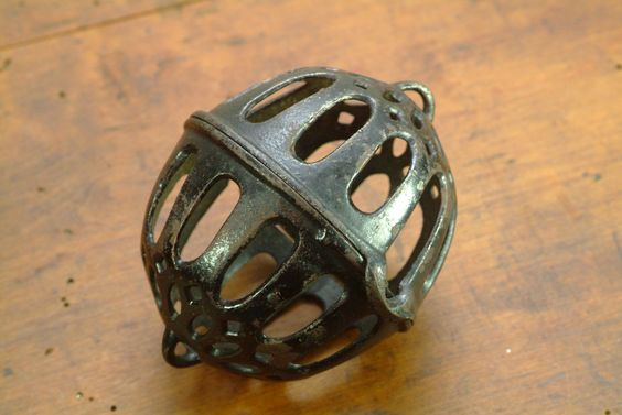 Antique Cast Iron Hanging String Ball Holder.