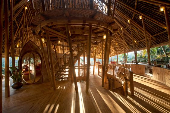 bamboo houses shape ibuku's green village community in indonesia | 'green village' by ibuku, bali, indonesia | image © ibuku | all images courtesy of green village. working in conjunction with the green school in bali, the 'green village' is a community of ecological houses sitting along the ayung river, within walking distance of the educational facility.