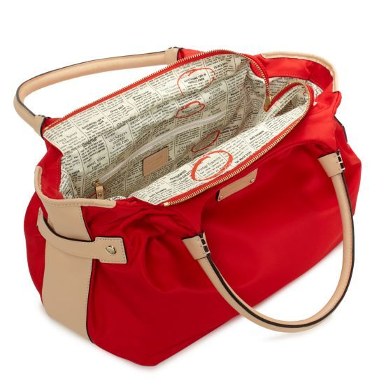 Kate Spade purse with newspaper print lining. <3