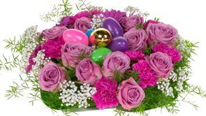 An Easter Centerpiece filled with colorful eggs - shows a great way to green foam ring!