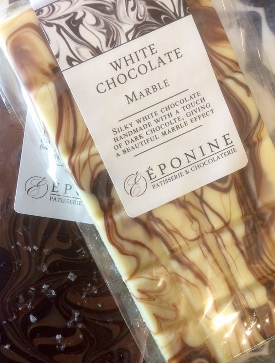 """Celebrating Chocolate Week with a photograph of our White Chocolate  Marble bar. Each bar is handmade with creamy white chocolate and a touch of dark chocolate, revealing a unique pattern for every bar. Available online in our boutique : http://eponine.co.uk/product/white-chocolate-marble-bar/ """"Come and check out these beautiful chocolates from @EponinePatiss this #ChocolateWeek"""" (Photograph by @whitmorewhite) (Eponine Patisserie & Chocolaterie)"""