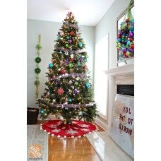 professionally decorated christmas trees with ribbon