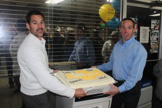 owners josh dusty cummins cutting the chevrolet 100th anniversary cake at dan cummins paris. Black Bedroom Furniture Sets. Home Design Ideas