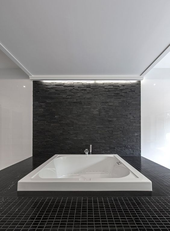 Luxurious Master Bathroom Tub Idea In Light White With Grey Stone Background Idea To Match Dark Tiled Floor