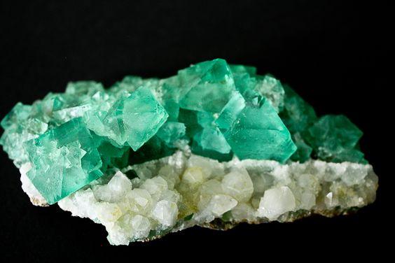 Gemmy green fluorite on white quartz