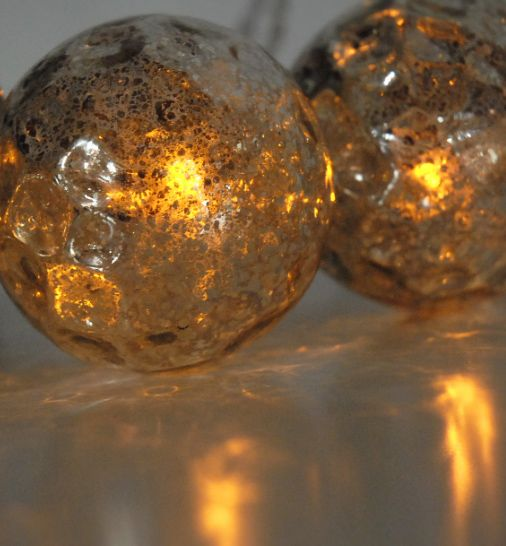 solar powered hand-blown Mercury Glass Globe LED Solar String Lights. Six globes crafted from ...