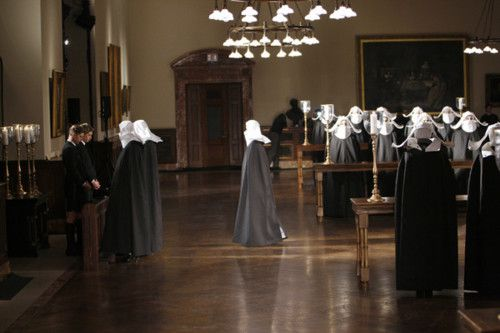 A bevy of nuns graced the Edna Barnes Salomon Room at the Stephen A. Schwarzman Building on 42nd Street during Thom Browne Catwalk Fashion Show in February 2011