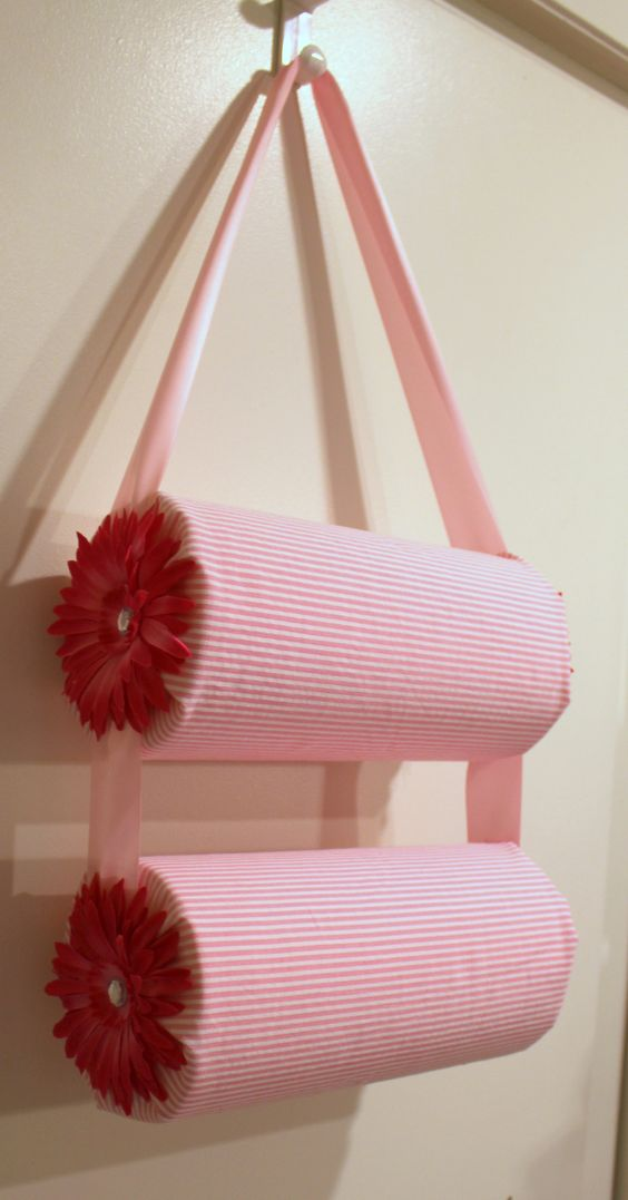 Chels we can totaly do this for Aspen's collection lol.....Headband Holder!    Pool Noodle, Ribbon, and Fabric is all we will need!