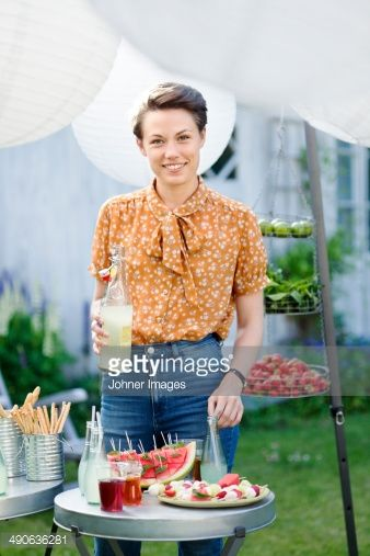 View Stock Photo of Smiling Woman With Drink At Garden Party. Find premium, high-resolution photos at Getty Images.