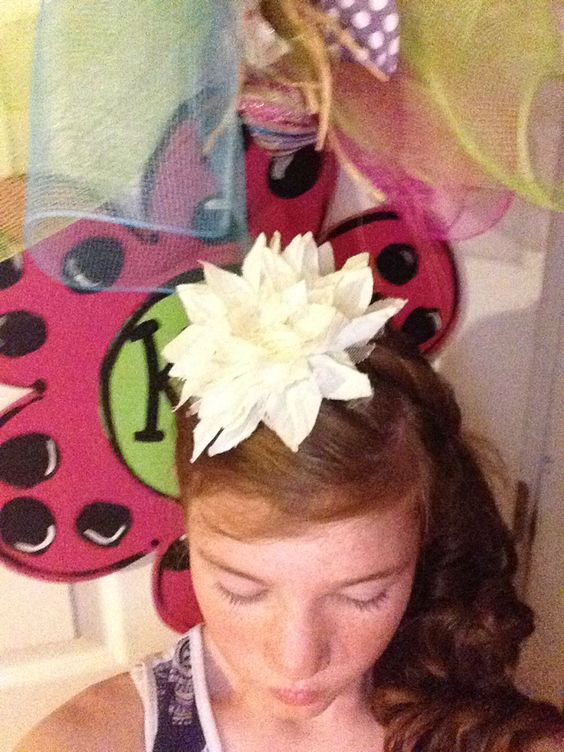 So cute I just put my hair in piggy tails curled one side didn't feel like doing the other side took it down and twisted it around my head and added a bow on the bobby pins