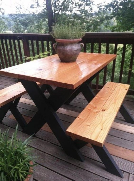Here's a really classy at a picnic table. Finished wood on top and black painted legs.