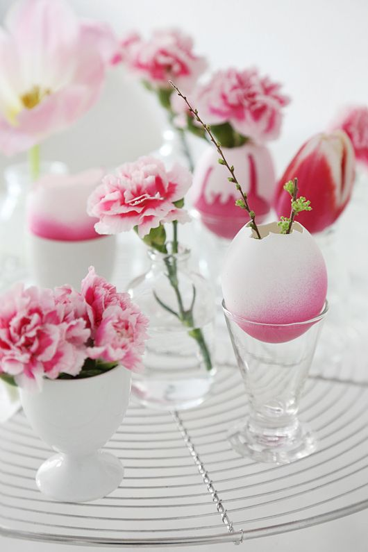 Use knocked egg shells like vases. Dip them in a dye. Fill them with pretty tulips.