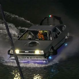 Giants fans are nuts.   Who knows what you will see in McCovey Cove.  In this case, a DeLorean hovercraft.