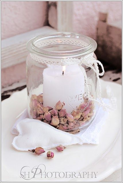 dried pink flowers to ornate a candle in a jar