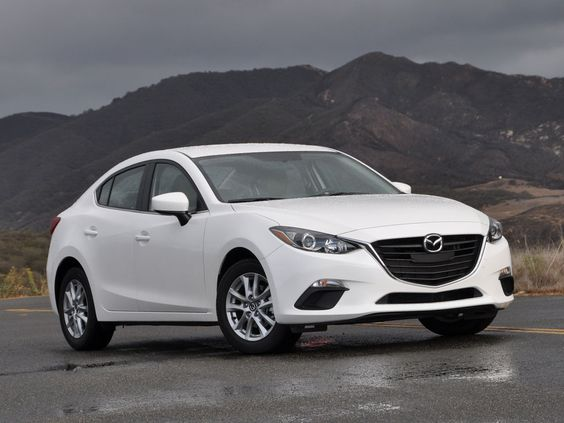 WINNER!!! 2014 Mazda 3. Bought it and love it. Benchmarked BMW and Audi.  Sporty, luxury, roomy, great handling, excellent MPG with nice pick up. Beats out all in class and above.