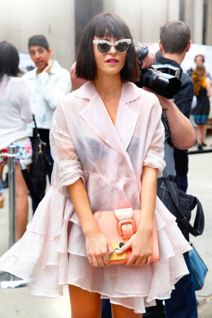 Sophia, founder of Nasty Gal, in a Dolce & Gabbana dress with a Marni bag #streetstyle #NYFW