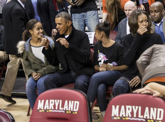 Attending First Lady's Brother Craig Robinson' basketball game.  11/2013