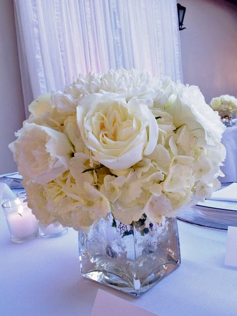 white rose and hydrangea centerpiece in silver mercury ...