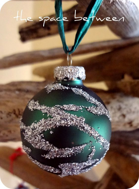 cover scratches on old baubles with glue and glitter